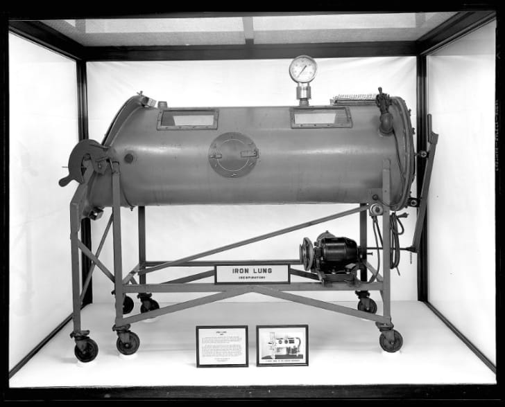 An iron lung medical device sits on display
