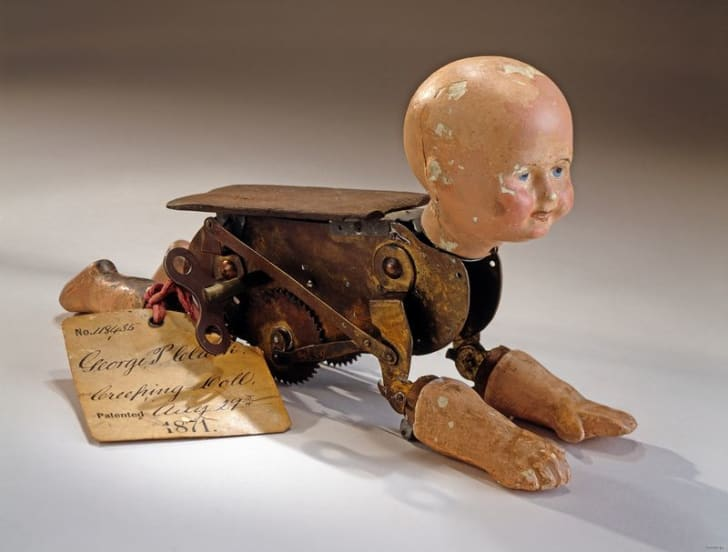 A vintage doll that crawls has a patent notice attached to it