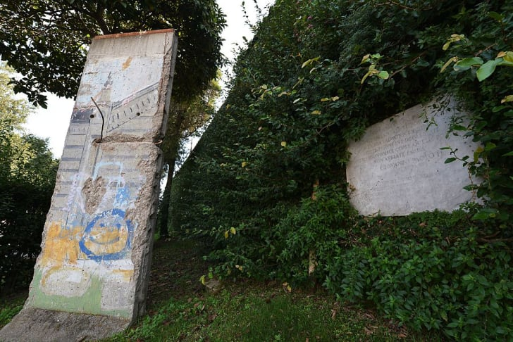 A piece of the Berlin wall in the Vatican gardens in 2014