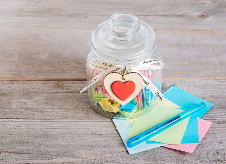 Glass jar filled with colorful notes.