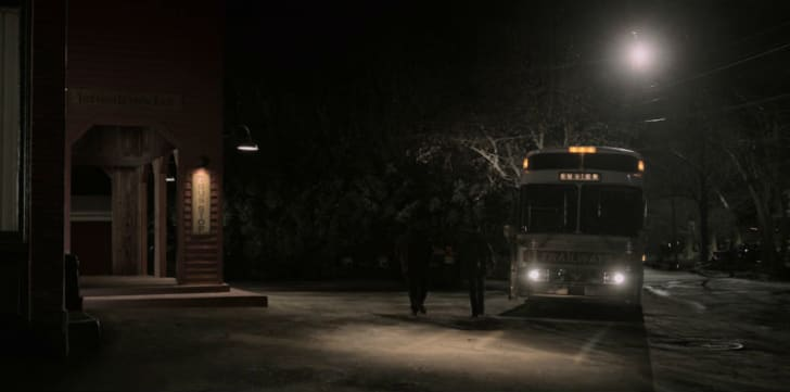 A bus pulls up to a Jerusalem's Lot bus stop in a screen capture from 'Castle Rock'