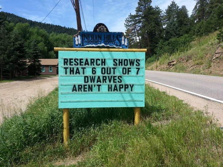 "A sign reads ""Research shows that 6 out of 7 dwarves aren't happy."""