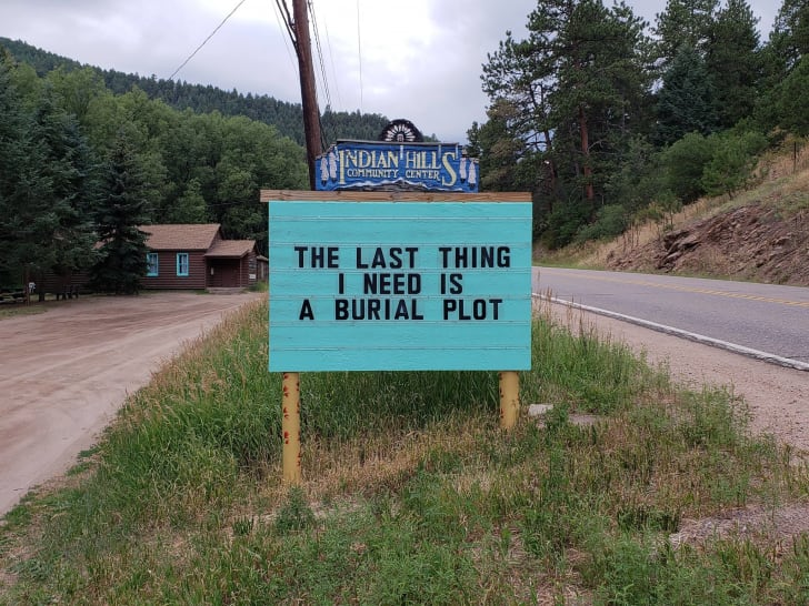 "A sign reads ""The last thing I need is a burial plot."""
