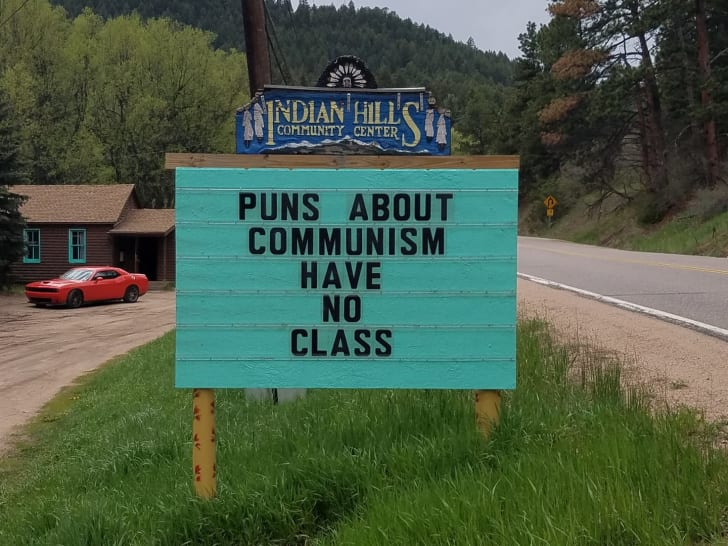"A sign reads ""Puns about communism have no class."""