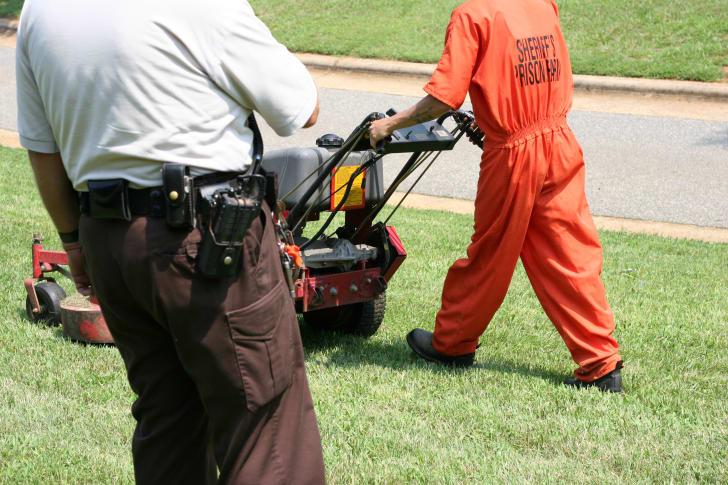 Prison Laborer mowing a lawn