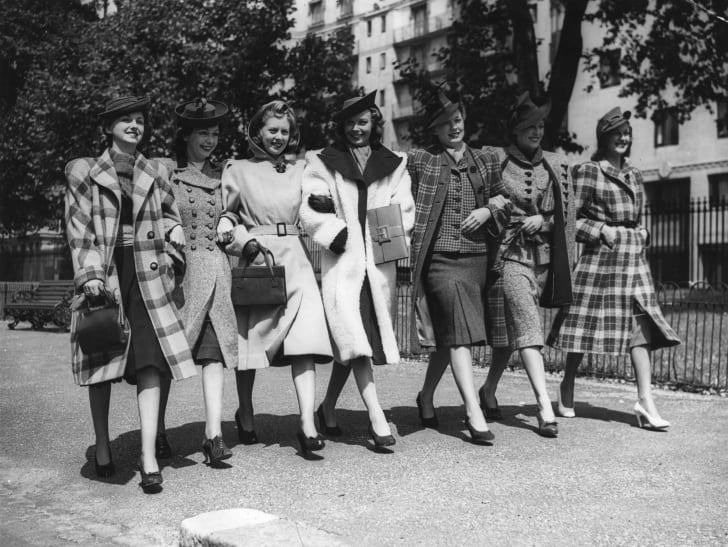 A group of models wearing new fashions for American women preview the collection in August 1940.