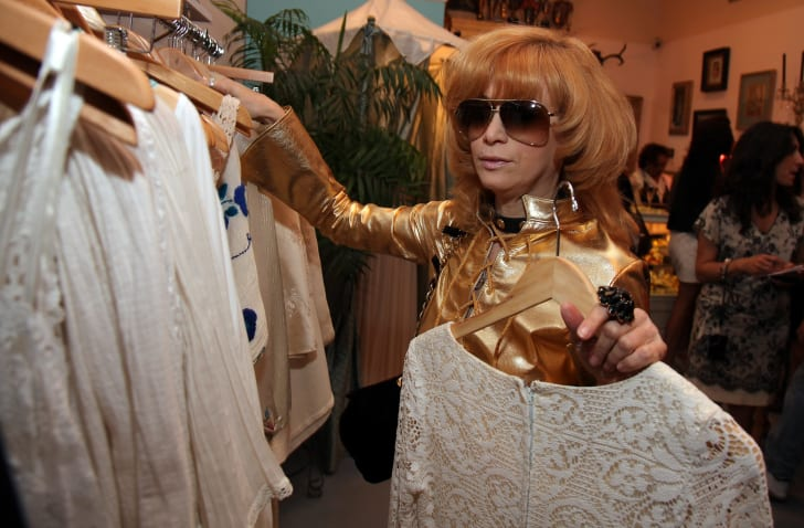 Linda Ramone browses vintage clothes in 2010.