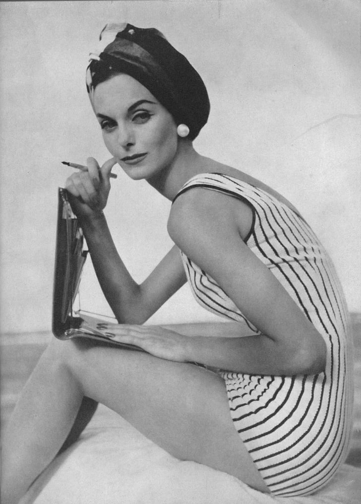 A woman models a swimsuit in a 1956 issue of Vogue.