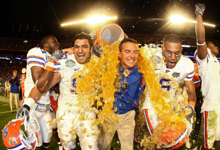 A University of Florida coach is soaked in Gatorade by his players after a win