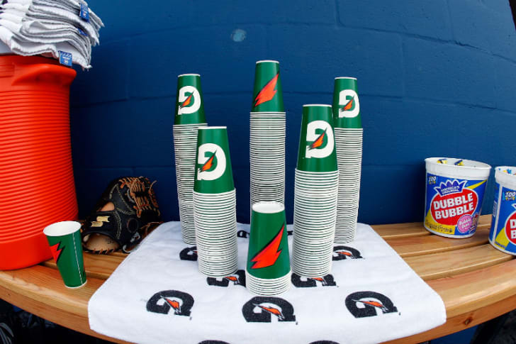 Gatorade cups are shown stacked in a locker room