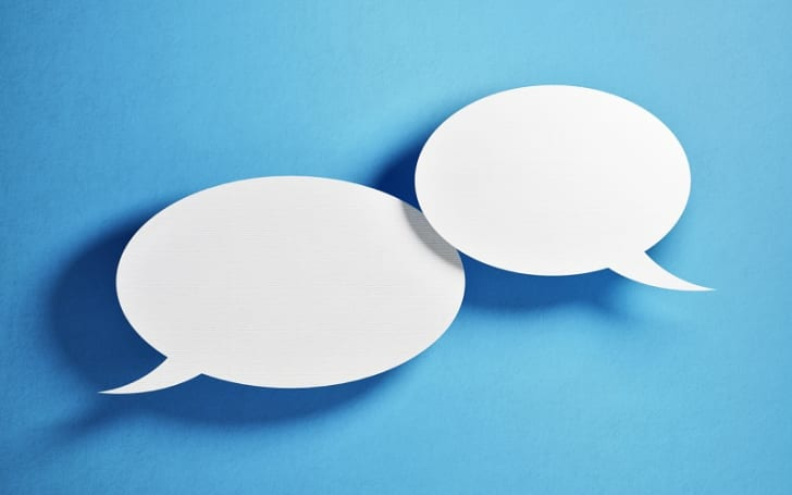 Two word balloons represent the concept of social networking