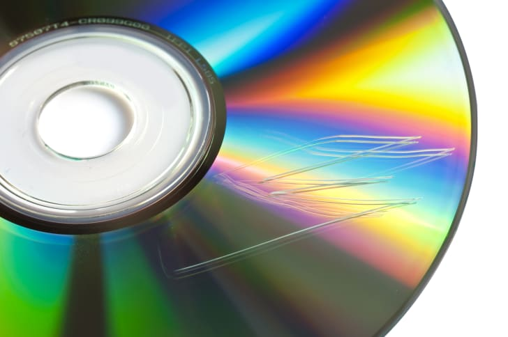 Close-up of CD with scratches.