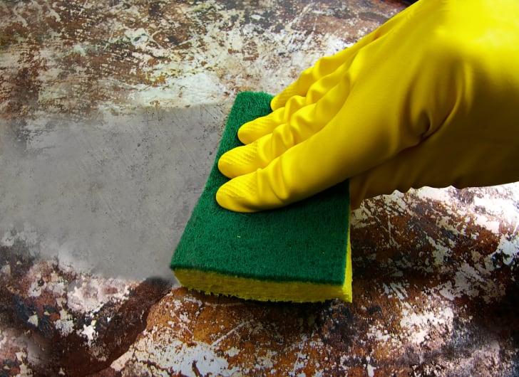 hand scrubbing a pan