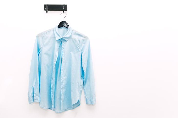 Wrinkled shirt hanging up.