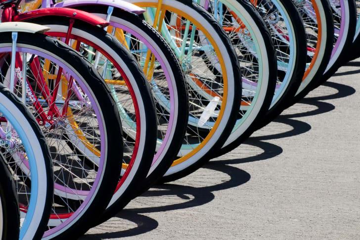 A series of colorful bike wheels.