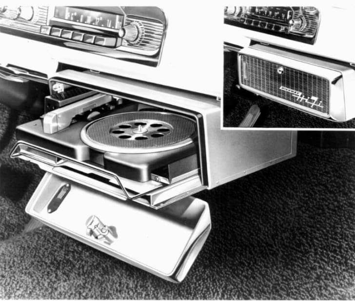 A Chrysler car record player mounted under the dashboard