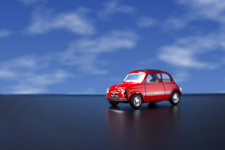 fiat toy car against blue sky background
