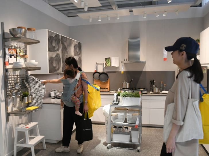 Customers inspect goods at an IKEA