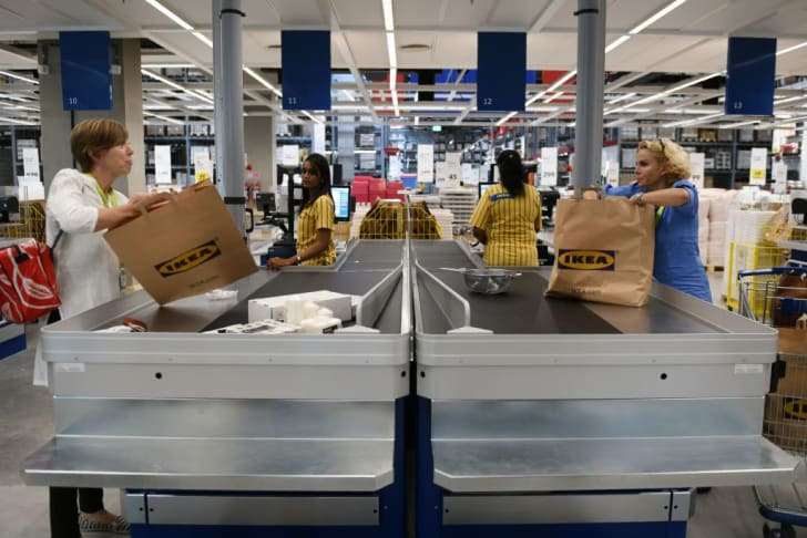 Customers at a check-out line in IKEA