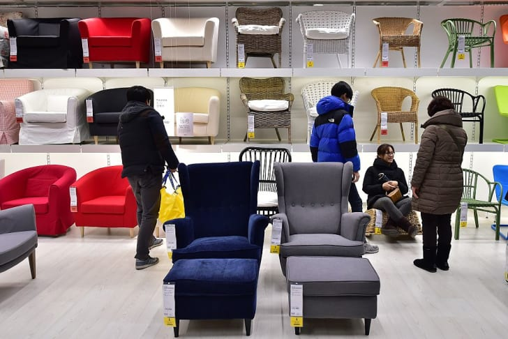 People look at chairs in a South Korean IKEA