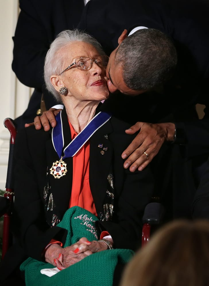 U.S. President Barack Obama kisses former NASA mathematician Katherine G. Johnson after he presented her with the Presidential Medal of Freedom during an East Room ceremony November 24, 2015 at the White House