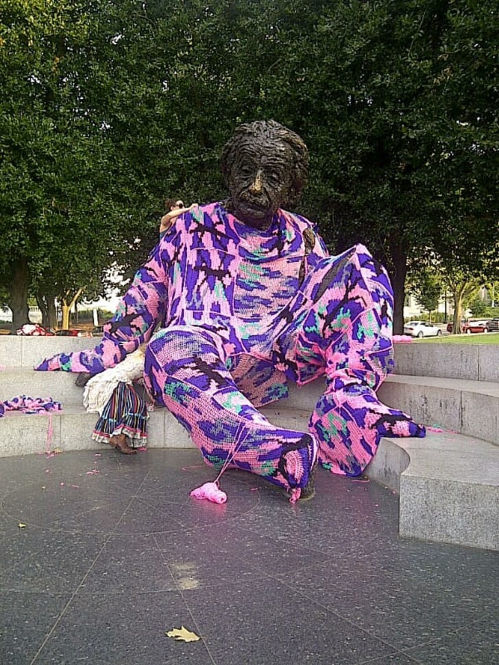 A statue of Albert Einstein wrapped in yarn.
