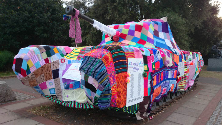 A tank covered in bright yarn.
