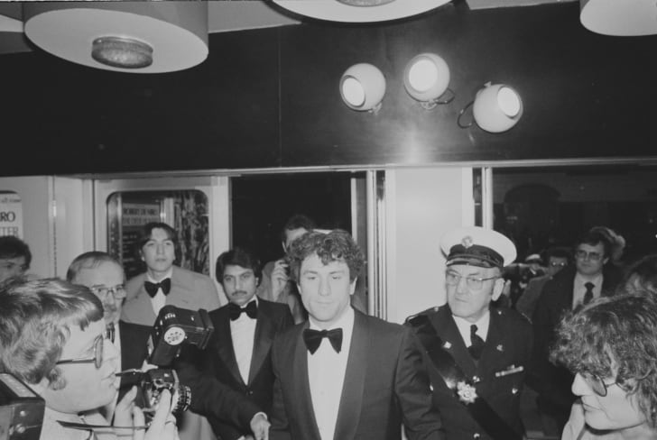 Robert De Niro arrives at the UK premiere of epic war drama film 'The Deer Hunter', UK, 28th February 1979