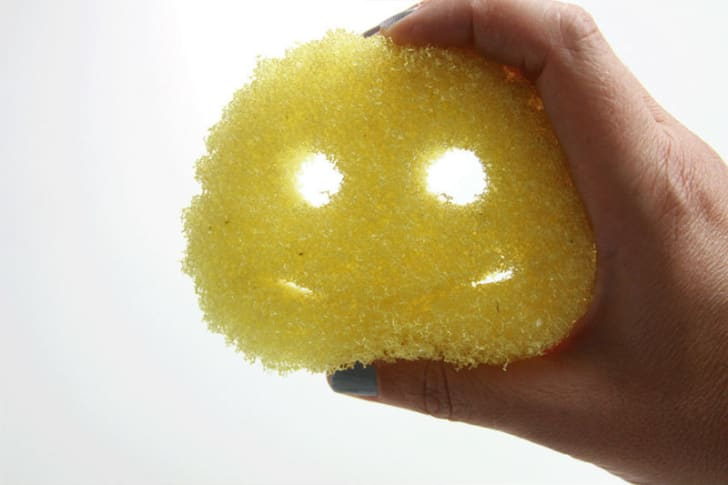 A person holds up a Scrub Daddy kitchen sponge