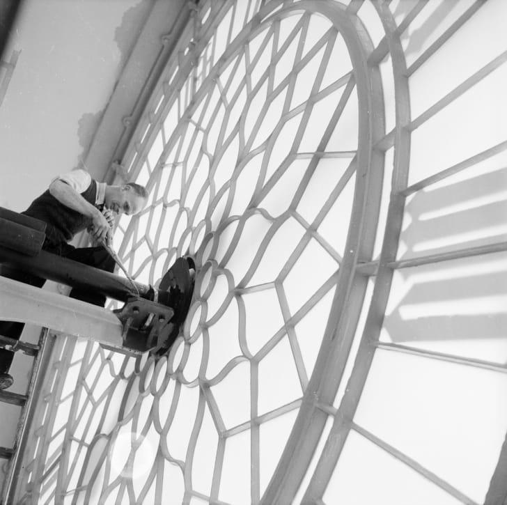 A clockkeeper works on London's Big Ben in 1957.