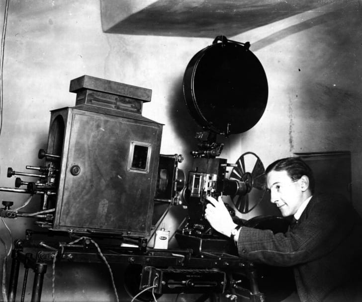 A projectionist in a town cinema, circa 1930.
