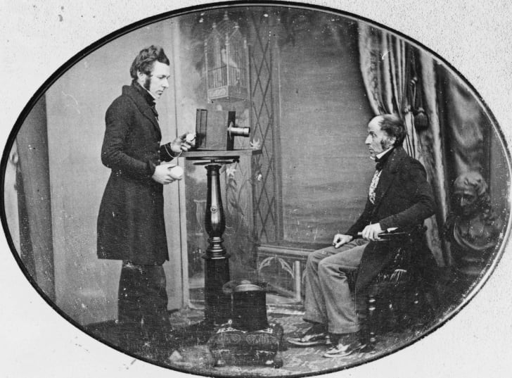 Jabcz Hogg photographing W S Johnston in the first known image of a photographer at work, circa 1843.