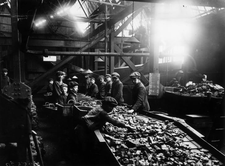 Young boys working the troughs in the mines of South Wales, circa 1910.