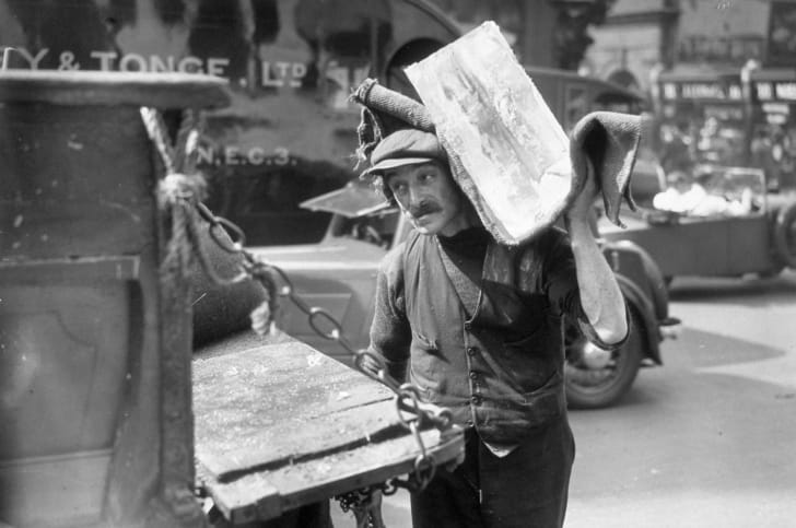 An iceman delivers blocks of ice in 1932.