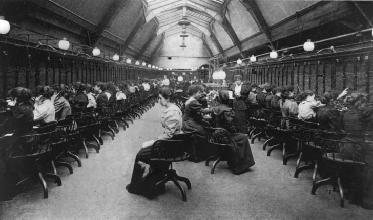 Switchboard operators at the Manchester Telephone Exchange, circa 1900.
