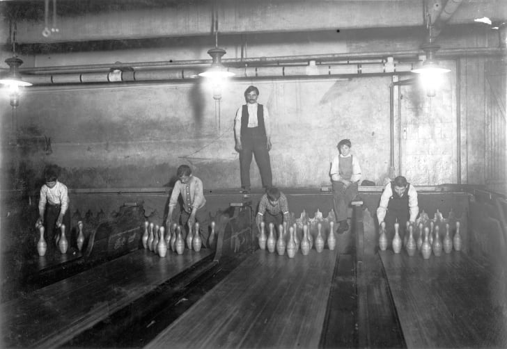 Child pinsetters working in a bowling alley in Brooklyn, New York in 1910.