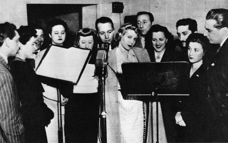 Eva Duarte (center, in 1944) made her name as a radio actress before marrying Juan Perón and becoming the First Lady of Argentina.