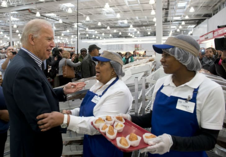 Vice-president Joe Biden greets food sample servers at a Costco