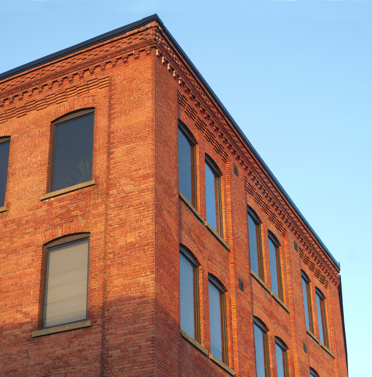 brick building against blue sky