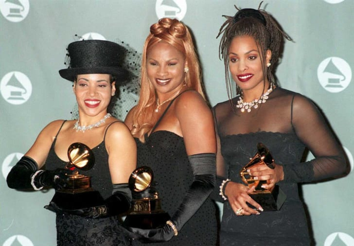 Salt-N-Pepa pose with their Grammys for Best Rap Performance by a Group at the 37th annual Grammy Awards in 1995