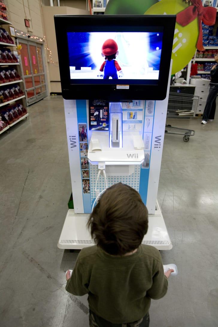 little boy plays Super Mario Wii game