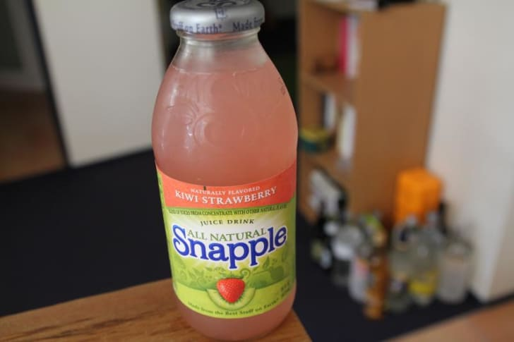 A bottle of Snapple sits on a table
