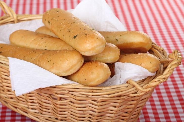 image of a basket of garlic breadsticks