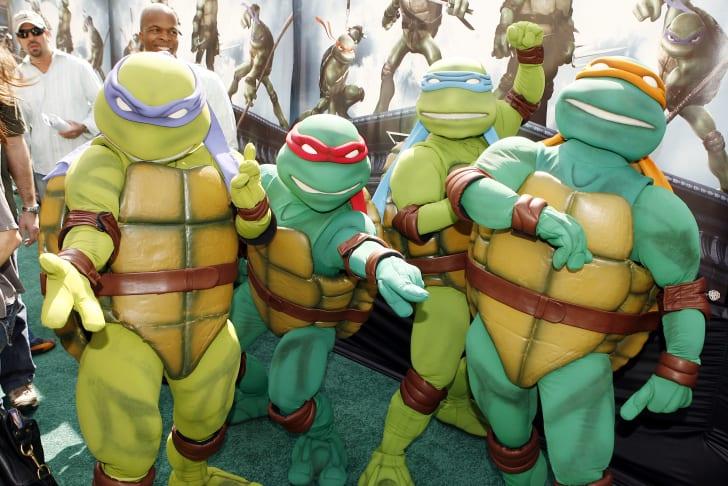 image of people dressed as the Teenage Mutant Ninja Turtles