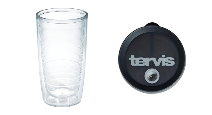 A clear plastic tumbler and black lid that reads 'Tervis'