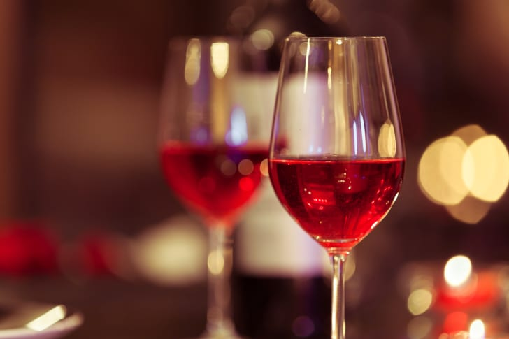 image of wine glasses filled with red champagne