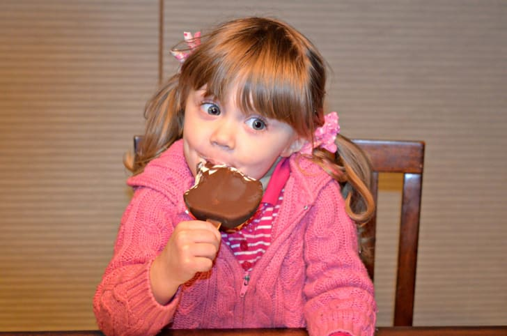 image of a young girl eating a dilly bar