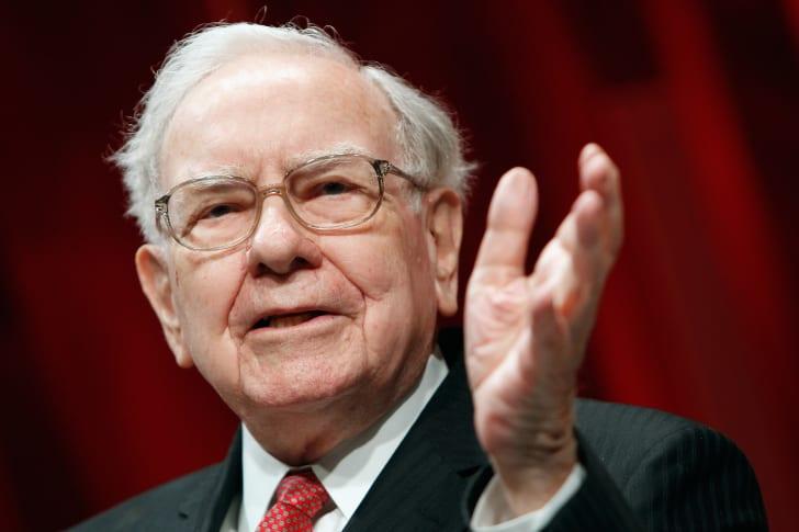 image of Warren Buffett gesturing toward an audience
