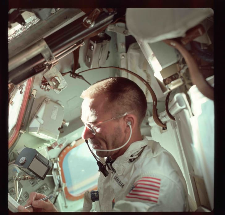 Astronaut Walt Cunningham, pilot of the Apollo 7 mission, uses the Fisher Space Pen while in flight.