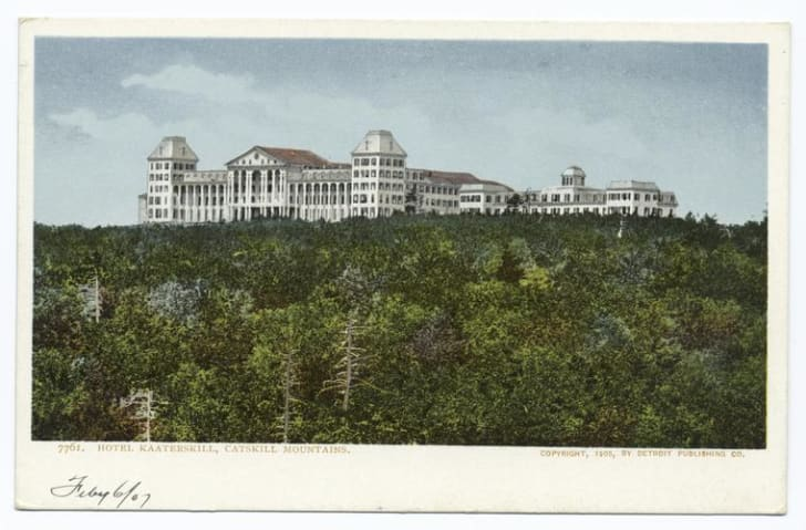 A vintage postcard shows a grand hotel in the middle of the wilderness.